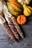 Flint Corn, Gourds, and squash on a rustic wood surface. Autumn Still Life: Flint Corn, Gourds, and squash on a rustic wood surface Stock Images