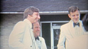 FLINT, MICHIGAN. 1968: Dad being cool around the groomsmen before the wedding. stock video