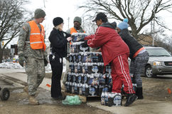 Flint, Michigan: Emergency Water Distribution. FLINT, MICHIGAN-January 23, 2016:Flint bottled water distribution by National Guardsmen in Downtown Flint royalty free stock photography
