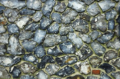 Flint stone wall background Royalty Free Stock Photos