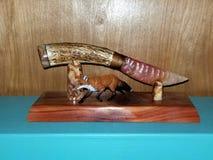 Flintknapped knife. Mookaite knife blade, elk antler handle. Native hand made Stock Photo