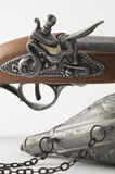 Flintlock Pistol and Gunpowder Flask. Stock Photos