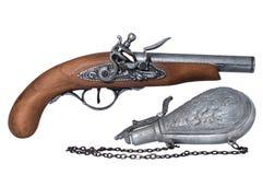 Flintlock Pistol and Gunpowder Flask. Replica Flintlock Pistol and Gunpowder Flask isolated on white stock images