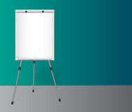 Flip chart with a blank sheet of paper near colored wall in the office. Stock Photos