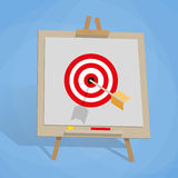 Flip chart with target, and arrow Royalty Free Stock Image