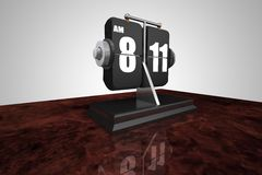 Flip Clock on a Burl Wood desk Royalty Free Stock Photos