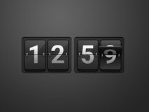Flip clock show 12:59. On dark grey background. New year countdown Royalty Free Stock Photos