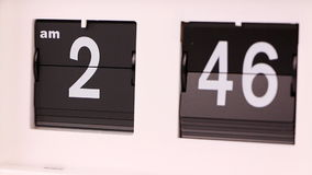Flip clock. Showing morning hours stock video footage