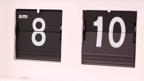 Flip clock. Showing morning hours stock footage