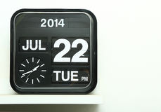 Flip clock. On white shelf stock photography