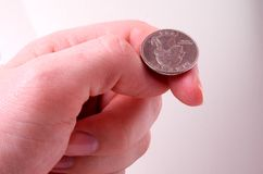 Flip a coin. Getting ready to flip a coin royalty free stock photo