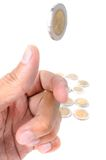 Flip the coin. Man ready to flip Thai 10 Baht coin on white background royalty free stock images