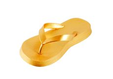 Flip flop. Golden flip flop isolated on the white background stock image
