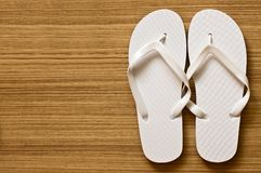 Flip-flop. On wood floor Royalty Free Stock Photo