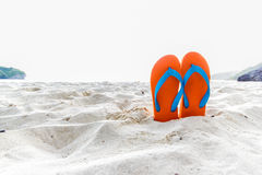 Flip-flop on the beach Royalty Free Stock Images