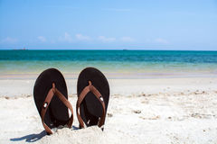 Flip-flop on the beach Royalty Free Stock Photos