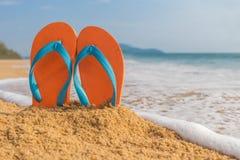 Flip-flop on the beach Stock Photos