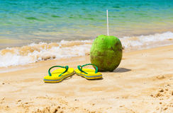 Flip flop and coconut on beach in Buzios, Rio de Janeiro Stock Images