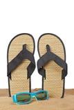 Flip-flop en la arena imagen de archivo libre de regalías