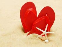 Flip-flop en la playa Fotografía de archivo libre de regalías