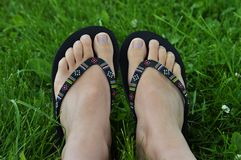 Flip flop feet Royalty Free Stock Images