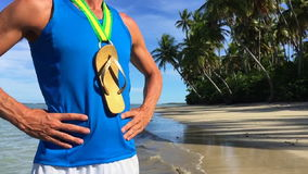 Flip Flop Gold Medal Brazilian Athlete Beach. First place Brazilian athlete standing with flip flop gold medal on empty beach stock video