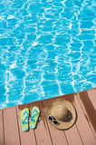Flip-flop near swimming pool Stock Images