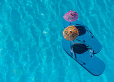 Flip Flop on pool with surface Stock Image