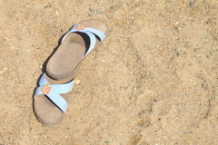 Flip-flop on sand Royalty Free Stock Images