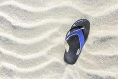 Flip flop on the sand Stock Photos
