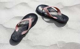 Flip flop on sand at a beach Royalty Free Stock Images