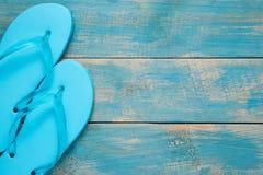 Flip-flop, Sandal, Summer. Blue flip flop sandals on blue wood.  Royalty Free Stock Photo