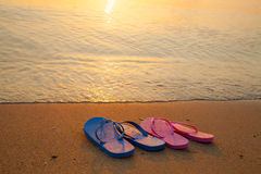 Flip flop sandals on the beach Stock Images