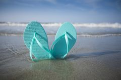 Flip Flop Sandals in the Sand at the Beach royalty free stock photos