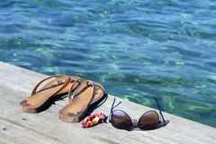 Flip-flop, sunglasses and  bracelets Royalty Free Stock Photos