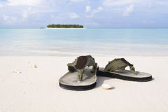 Flip-flop on white sand beach Royalty Free Stock Image