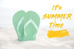 Flip flop on the white sand beach. Summer time stock photo
