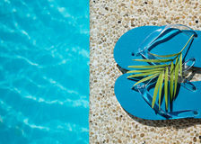 Flip Flop on Wood Floor pool edge with surface of water background Stock Image