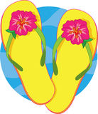 Flip Flops. A pair of yellow flip flops with a pink hibiscus blossom Royalty Free Stock Image