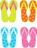 Flip flops. Four pairs of colorful flipflops - beach sandals Royalty Free Stock Photo