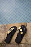 Flip flops. Two flip flops near the swimming pool royalty free stock image