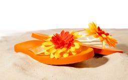 Flip-flops. On a sunny beach Royalty Free Stock Photo