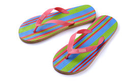Flip-flops. Pair of striped flip-flop sandals isolated on white stock image