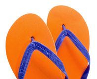 Flip-flops. A pair of orange flip-flops on a white background stock image