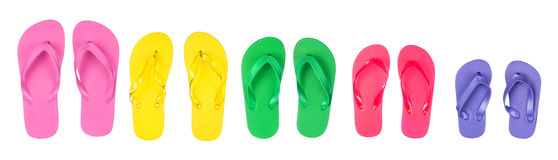 Flip flops. A selection and assortment of rubber flip flops in multiple colors stock images