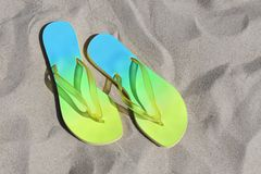 Flip-flops. A pair of flip-flops on a sandy beach stock photos