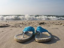 Flip-flops. Sandals, flip-flops on the beach Stock Image