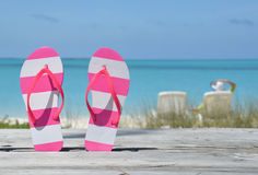 Flip-flops against ocean Stock Photo