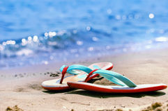 Flip flops alone on a beach Stock Images