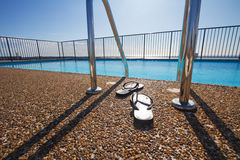 Free Flip Flops At A Pool Edge Nobody Stock Photography - 62374922